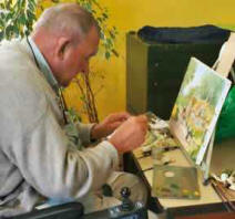 man painting a picture for grief therapy